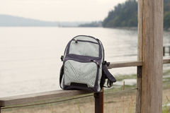 Backpack on Fence Royalty Free Stock Photography