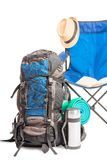 Backpack and folding chair ready for the trip to nature Stock Photo