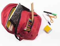 Backpack full of school supplies Stock Images