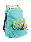 Backpack full of school supplies isolated on white background.  stock photos