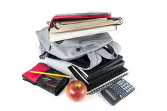 Backpack full of school supplies. on white background. Royalty Free Stock Image