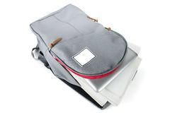 Backpack full of school supplies. on white background. Royalty Free Stock Photography