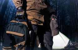 Backpack and gear woods composition. Royalty Free Stock Photo