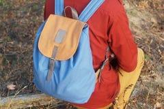 Backpack on girl's shoulders. Backpack hanging on the back girl's shoulders Stock Photography