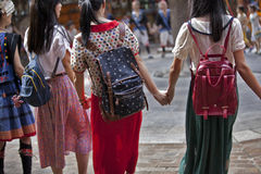 Backpack Girls. Travel around shoulder with shoulder Stock Photography
