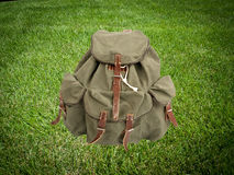 Backpack on the grass Royalty Free Stock Image