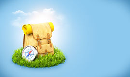 Backpack on grass Stock Photos
