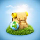 Backpack on grass Stock Images