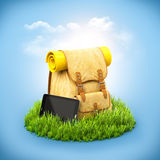 Backpack on grass Stock Photo