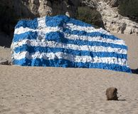 Backpack and greek flag. Painted on rock royalty free stock images
