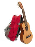 Backpack and guitar. Backpack and guitar on Isolated White Background Royalty Free Stock Photography