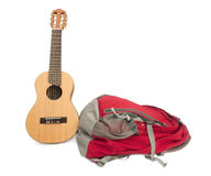 Backpack and guitar. Backpack and guitar on Isolated White Background Royalty Free Stock Image