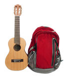 Backpack and guitar. Backpack and guitar on Isolated White Background Stock Photo
