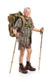 Созрейте при удерживание backpack hiking полюсы Стоковое Изображение
