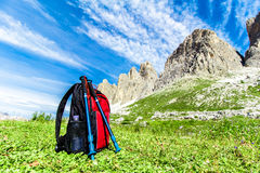 Backpack for hiking in the Alps. Backpack and hiking poles, for trekking in the Alps Stock Photos