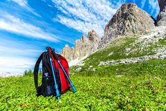 Backpack for hiking in the Alps. Backpack and hiking poles, for trekking in the Alps Stock Photography