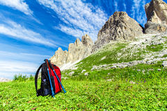 Backpack for hiking in the Alps. Backpack and hiking poles, for trekking in the Alps Royalty Free Stock Images
