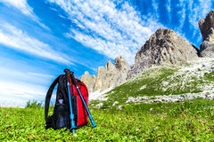 Backpack for hiking in the Alps. Backpack and hiking poles, for trekking in the Alps Stock Photo