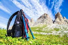Backpack for hiking in the Alps. Backpack and hiking poles, for trekking in the Alps Royalty Free Stock Image