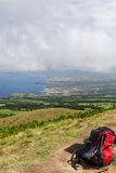 Backpack on Hill in front of Ocean, Sao Miguel, Azores, Portugal Royalty Free Stock Images
