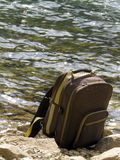 Backpack at the lake Royalty Free Stock Photo