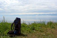 Backpack at the lake Stock Photo
