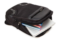 Backpack with a laptop and books Royalty Free Stock Photos