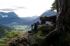 Backpack leaning on a tree with a scenic view stock photos