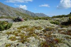 Backpack lies on the high meadows Barguzinsky Ridge on Lake Baik Stock Photos