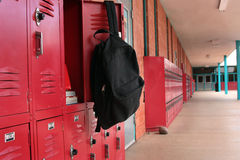 Backpack on locker Royalty Free Stock Photography