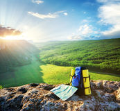 Backpack and map. In mountain Stock Images
