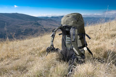 Backpack on meadow Stock Photos