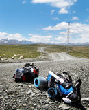 Backpack in mountain. Two backpack on mountain way in Kirghistan Royalty Free Stock Photo