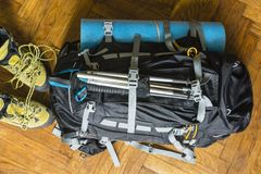 Backpack and mountain boots prepared for the trip. Mountain boots and backpack with trekking sticks and sleeping pad to prepare for the trip Stock Photos