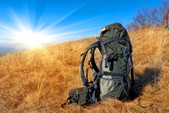 Backpack on  mountain meadow Stock Images