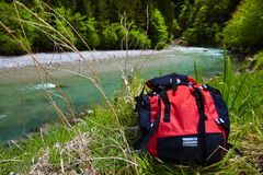 Backpack over stream Royalty Free Stock Images