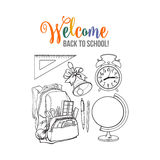 Backpack packed with school items, alarm clock, globe and bell Royalty Free Stock Photos