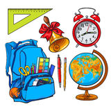 Backpack packed with school items, alarm clock, globe and bell Royalty Free Stock Image