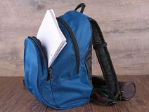 Backpack and paper Royalty Free Stock Image