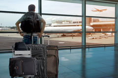 Backpack passenger in the airport terminal. Stock Images
