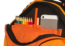 Backpack with phone Royalty Free Stock Photo