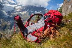 Backpack. Red hiking backpack in the alpine environment Royalty Free Stock Images