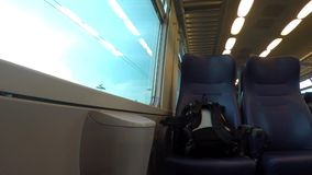 Backpack on a riding train. stock video footage