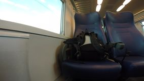 Backpack on a riding train. stock footage