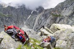 Backpack and ropes hiking around adamello park, glacier, Alps. Italy Royalty Free Stock Image