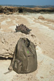 Backpack and sandals on rock Royalty Free Stock Photos