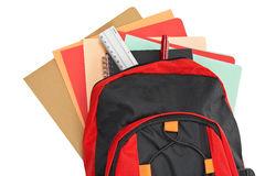 Backpack with school material Stock Photo