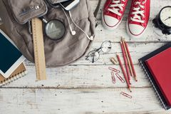 Backpack with school supplies. On desk Stock Photography