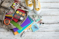 Backpack with school supplies. On desk Stock Photo