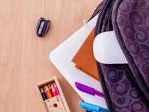 Backpack with school supplies laptop Royalty Free Stock Images